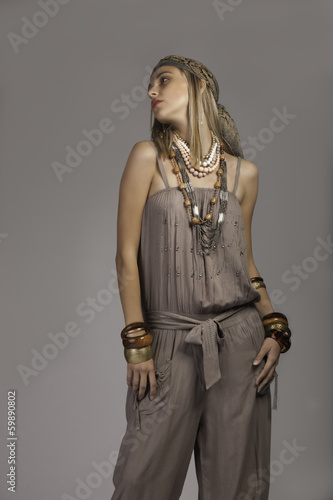 Blonde woman in bohemian clothing looking away