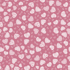 Seamless pattern with small white hearts on a pink background