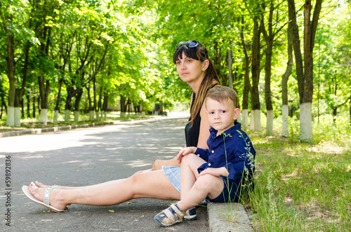 Mother and son waiting in a rural street