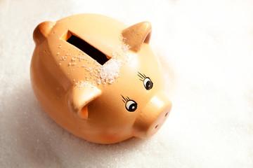 Piggy bank in a heap of sugar