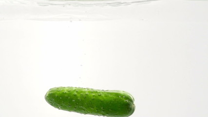 Green cucumber. Slow motion