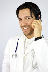 Happy doctor on the phone