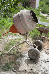 Cement mixer on courtyard with selective focus