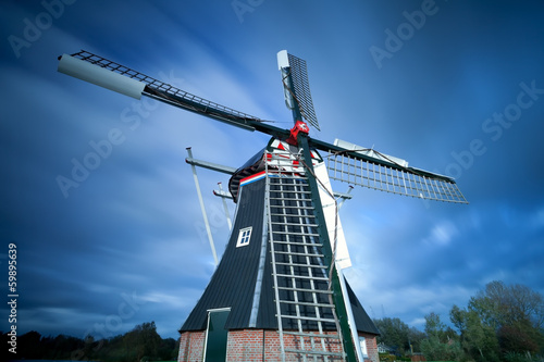Dutch windmill over sky