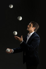 Young man juggling balls