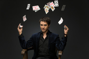 Young man juggling cards