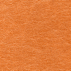 Background of bright orange leather texture