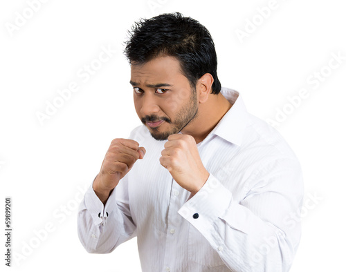 Angry, upset, business man ready to fight, fists in the air