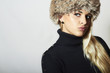 Beautiful Blond Young Woman in Fur Hat.Beauty Fashion Girl