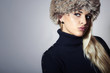 Beautiful Blond Young Woman in Fur Cap.Beauty Fashion Girl