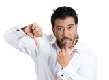 Annoyed man sticking out his tongue showing thumbs down