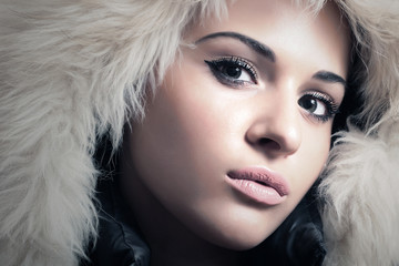 Young Beautiful Woman in Fur Hood. Winter Style