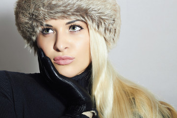 Blond Woman in Fur Hat.Beautiful Blond Girl in Leather Gloves