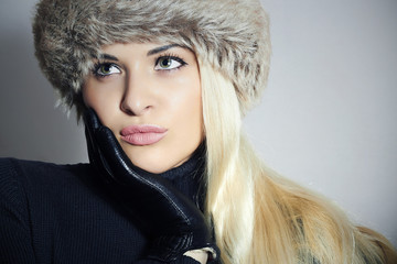 Beautiful Blond Woman in Fur Cap.Beauty Girl.Winter Style