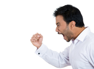 Side view portrait of yelling angry man