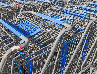 Shopping carts pushed together, close up view