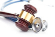 brown gavel and a medical stethoscope - 59900201