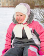 Happy little girl playing in cold winter snow