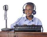 Young Boy Manning the Soundboard
