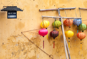 Different lanterns near wall in Vietnam, Asia.