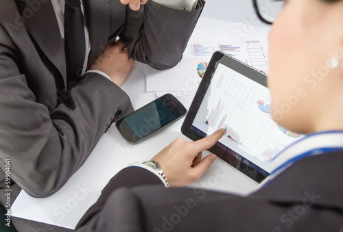 Businesswoman showing documents in digital tablet