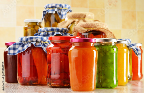 Jars of marinated food. Pickled vegetables and jams