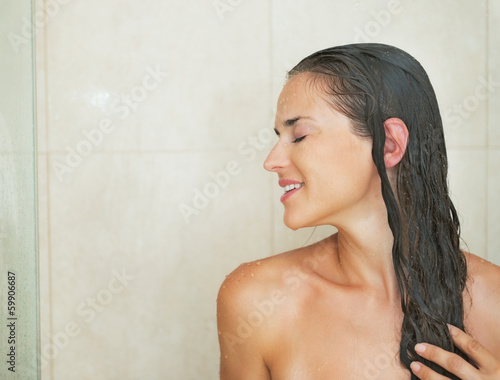 Profile portrait of young woman in shower