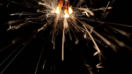 Firework sparklers burning in macro shot
