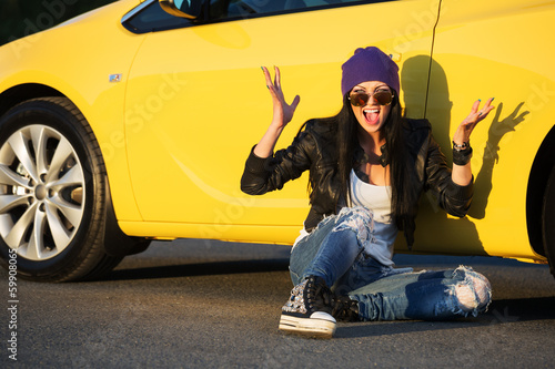 Angry fashionable punk woman sitting at the car
