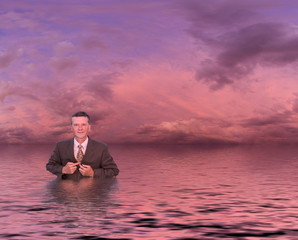 Senior man in suit in deep water