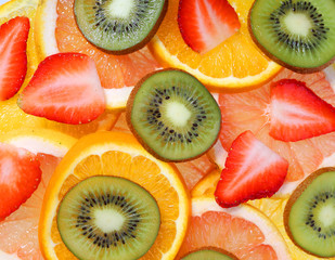 Sliced Fruits Background. Strawberry, Kiwi, Pineapple