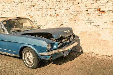 Abandoned vintage car after a frontal crash accident