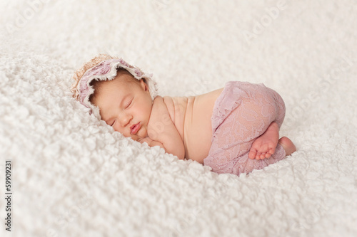 Portrait of a Newborn Girl with Lace Pants and Bonnet