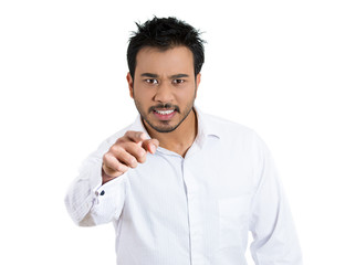 Angry man pointing, accusing someone of wrong doing