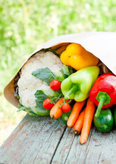 fresh organic  vegetables on a wooden bench