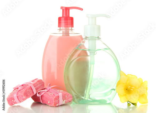 Liquid and hand-made soaps isolated on white