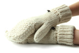 Hands in wool mittens, isolated on white