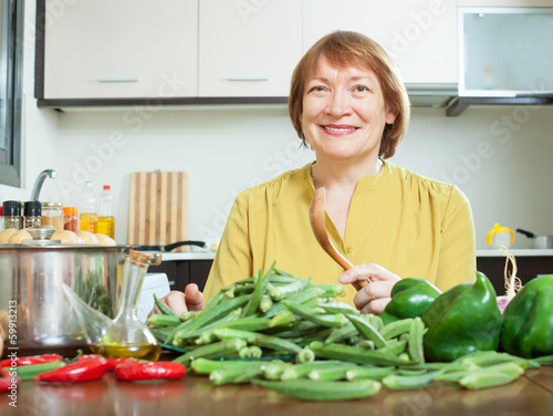 woman cooking okra and other vegetable