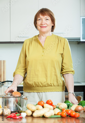 mature housewife with vegetables