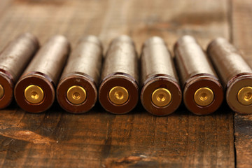 Shotgun cartridges on wooden table close-up