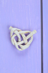 Heart shape from rope, on  color wooden background