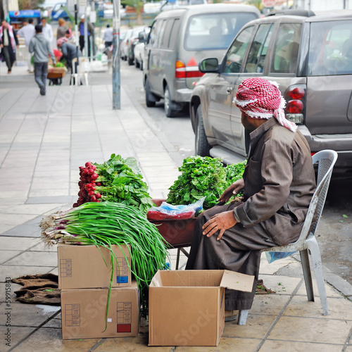 Pavement vendor selling vegetables in Aqaba