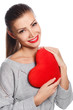 beautiful woman with bright makeup and red heart in hand