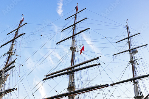 Three masts  fom a sailboat
