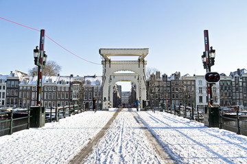 Snowy thiny bridge in Amsterdam the Netherlands in winter