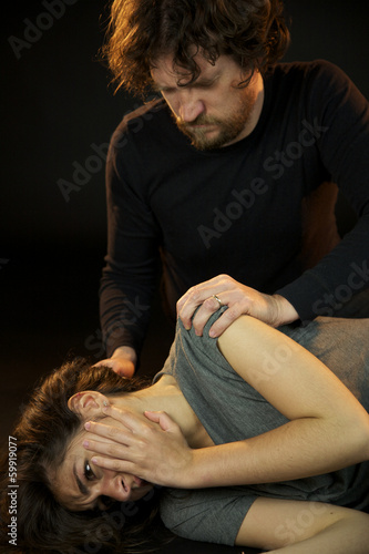 Man looking at his victim after abuse
