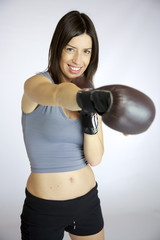 Woman boxer smiling and punching