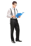 Full length portrait of young man reading papers
