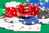 poker chips, dice and playing cards on the green table