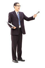 Survey conductor holding clipboard and microphone